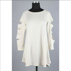 Razor cut cream tunic